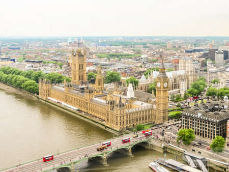 Aerial view of the Thames River, Houses of Parliament, Big Ben clocktower and Westminster Bridge. London, UK