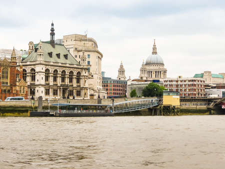 View of the Victoria Embankment, St. Paul's Cathedral and Thames River. Cityscape view of London, UK