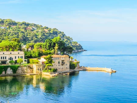 Villa in the small bay on the bank of the Mediterranean Sea. Landscape of the Cote d'Azur, Villefranche-sur-Mer, France