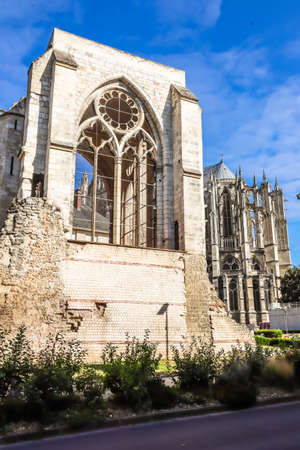 Ruins of the Saint Barthelemy collegiate church (11-18th centuries) and Beauvais Cathedral. Beauvais, France