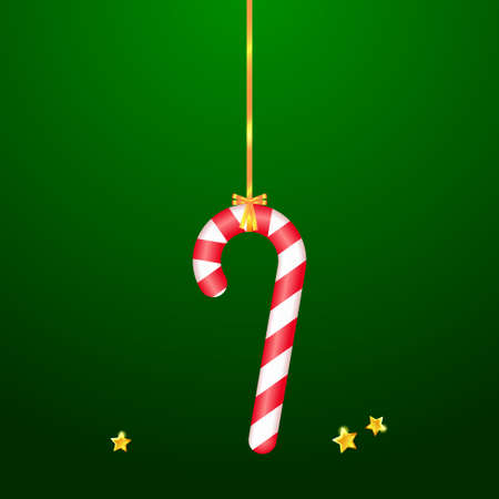 Christmas candy canes hanging on green