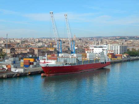 Cargo ship in the harbor of Catania, Sicily, Italy Stock Photo