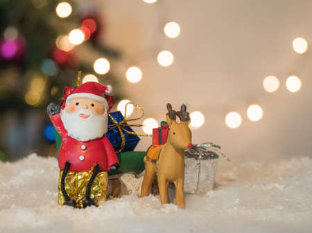 lug: reindeer lug green sleigh  santa claus sit on box gesticulate your hand and bokeh background