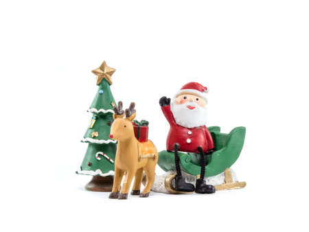 reindeer lug green sleigh  santa claus sit on gesticulate your hand isolated on white backgroun