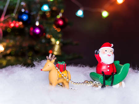lug: reindeer lug green sleigh  santa claus sit on gesticulate your hand