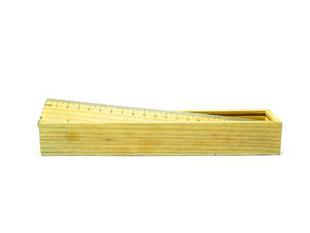 sliding scale: wood pencil box and ruler for work and study Stock Photo