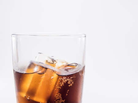 two and two thirds: close up two of thirds soft drink is cool and ice cubes  in glass on white background Stock Photo