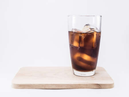 two and two thirds: soft drink is cool with ice cubes  two of thirds in glass on wood squares