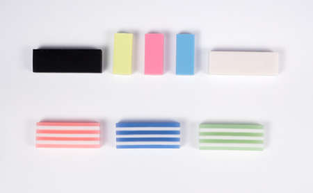 Colorful rubbers on white background