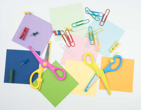 Note all colorful paper with paperclip and notepad with scissors and notepad, object concept on white background Banco de Imagens