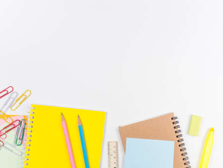 Note all colorful paper with paperclip and notepad, object concept on white background