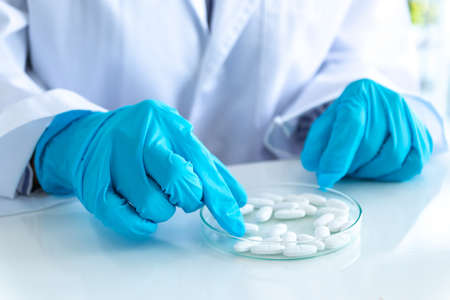 Scientists researching focus pills in laboratory