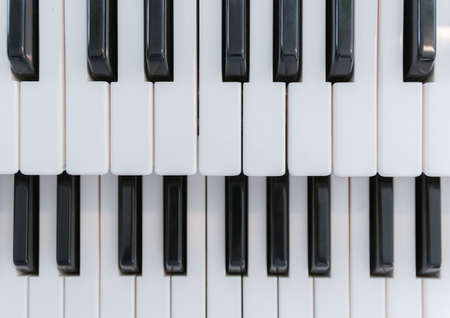 Top view and close up of a piano keyboard