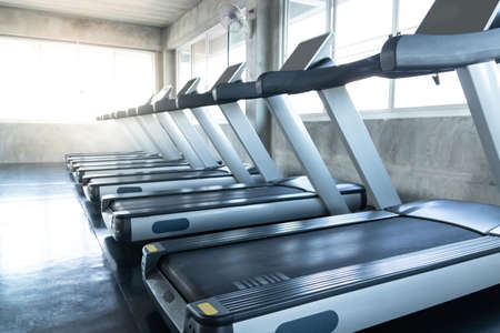 Treadmill at panoramic window in gym