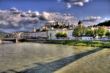 historical buildings in salzburg alongside a river Stock Photo