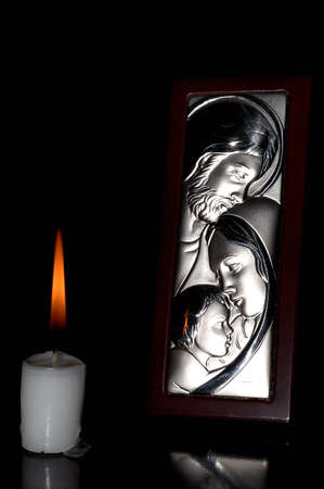 jesus mary joseph lighted with a candle