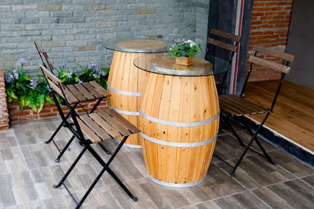 arranging chairs: chair and Oak Barrel table in Restaurant
