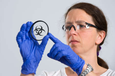testtube: woman in laboratory with object holder