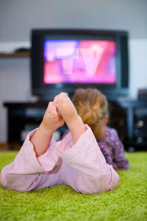 child is watching TV Stock Photo