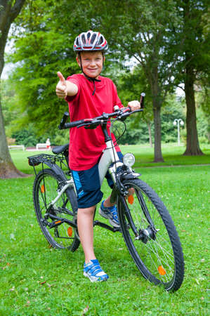 boy on bicycle with thumb up Stock Photo - 23697767