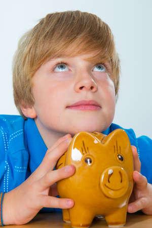 piggybank: boy with piggy-bank