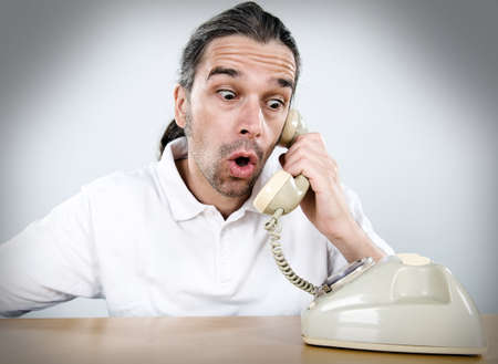 bald man: sudden telephone call  Stock Photo