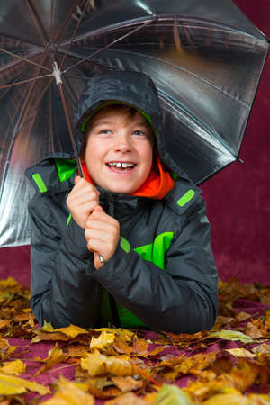 anorak: happy boy with umbrella