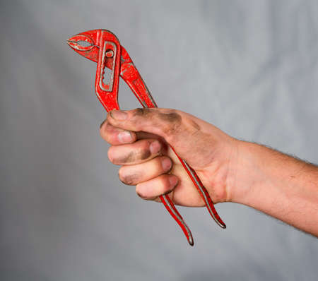hand gripper: hand with a pipe wrench