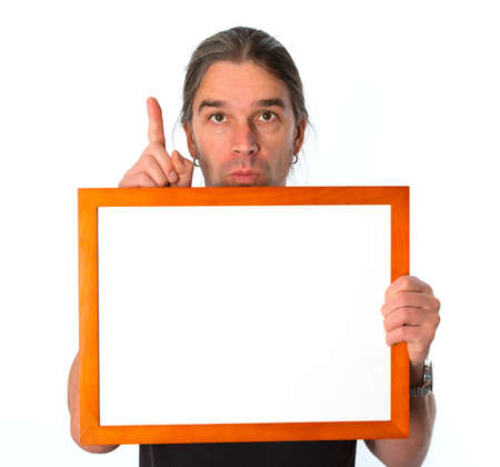 man with white signboard is showing the forefinger  photo