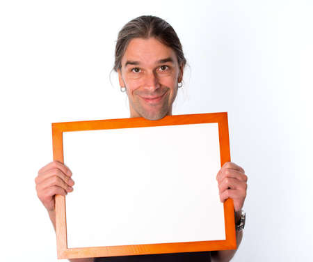 smiling man with white signboard  photo