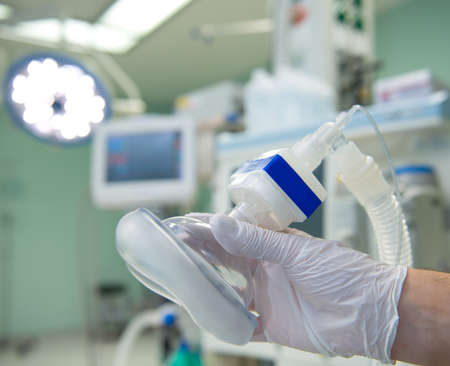 oxygen mask: anesthesia- doctors hand with mask Stock Photo