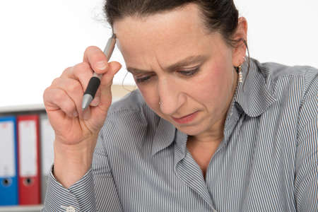 clerical: business woman is reflecting Stock Photo