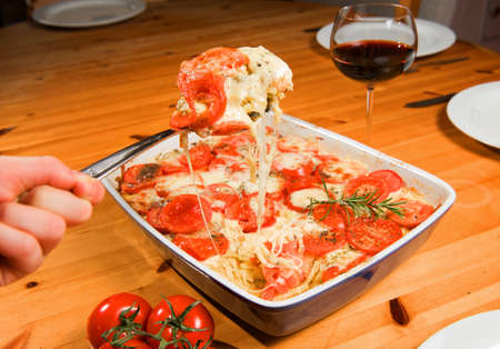 casserole with tomato and cheese photo