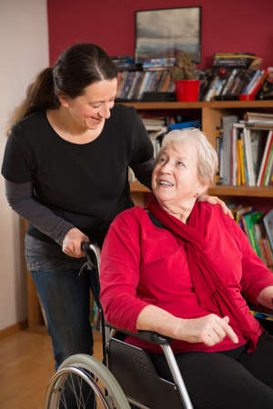 home health care: female senior in wheelchair at home Stock Photo