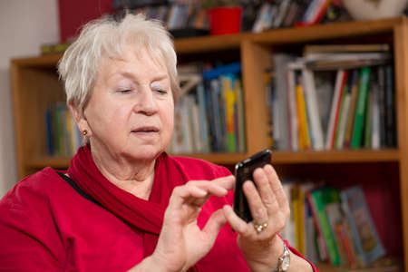 female senior with smartphone