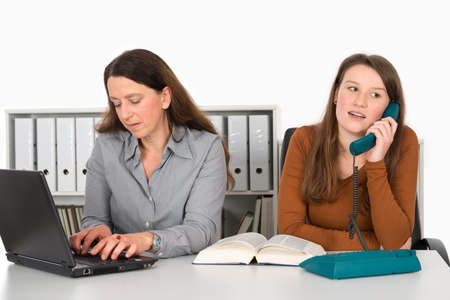 clerical: two women working in the office Stock Photo