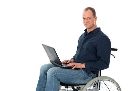 man in wheelchair is working with computer