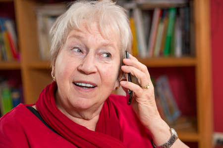female senior is calling with cellphone photo