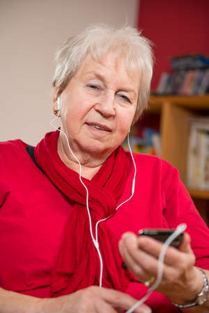 female senior listening music photo