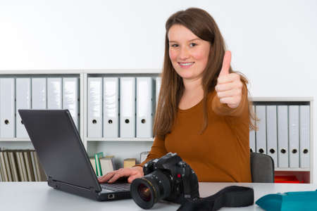 editorial: young reporter in editorial office Stock Photo