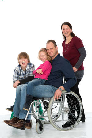 man in wheelchair with family photo
