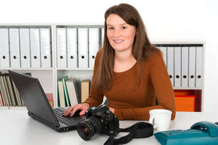 young female reporter in the office photo