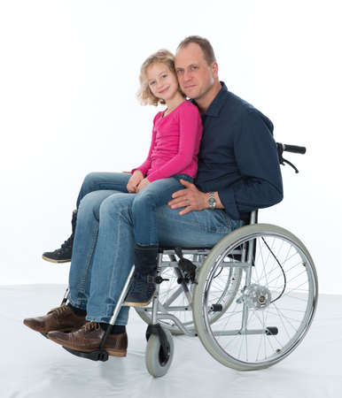 man in wheelchair with daughter Stock Photo