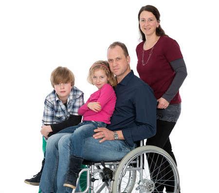 man in wheelchair with family 版權商用圖片