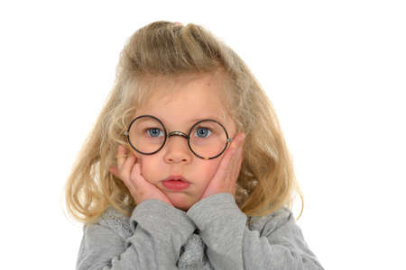 dullness: little girl with round glasses looking sad