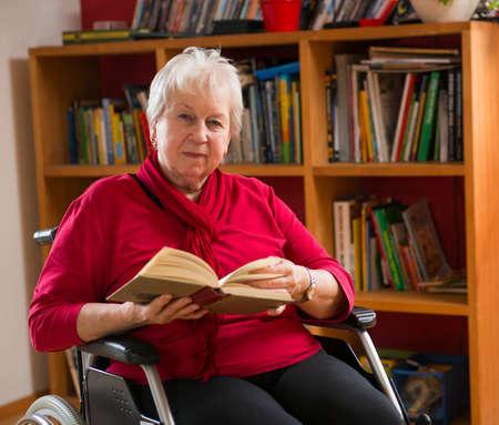 women subtle: female senior in wheelchair reading