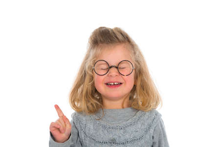 canny: clever girl with round glasses Stock Photo