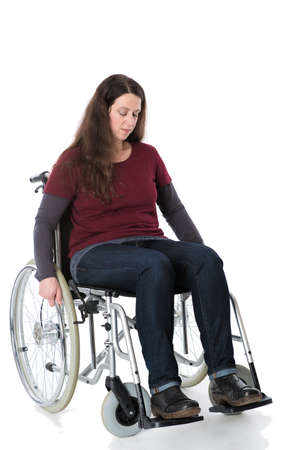 despaired: sad young woman in wheelchair