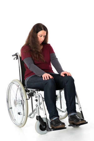 sad young woman in wheelchair 版權商用圖片 - 34950784
