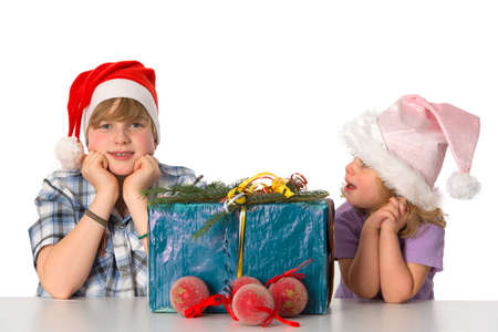 brother and sister with christmas present photo